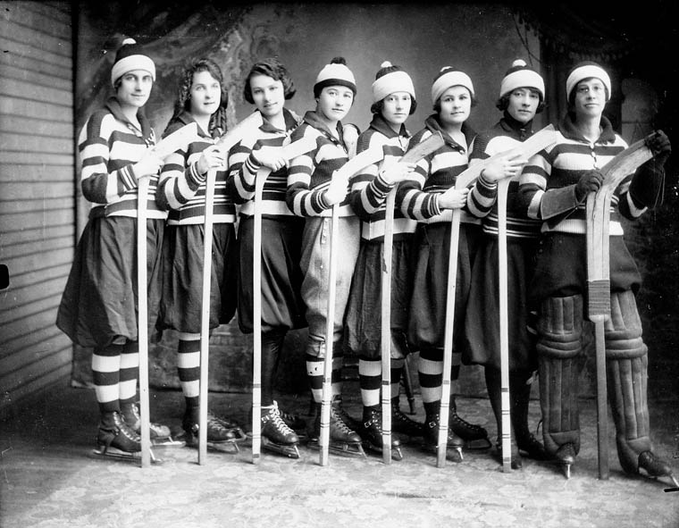 women play ice hockey